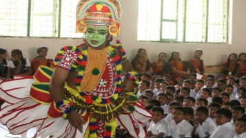 School reopening day celebrated with Oottamthullal of Kalamandalam, Nayanan